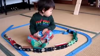 little boy enjoying with toys