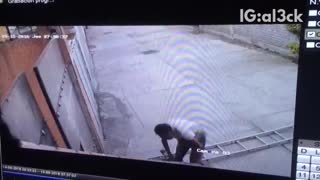 Security footage man on ladder falls down