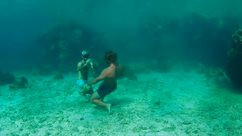 Free Divers Hold Their Breath And Battle It Out Under Water
