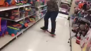 Guy in army sweater falls off red skateboard