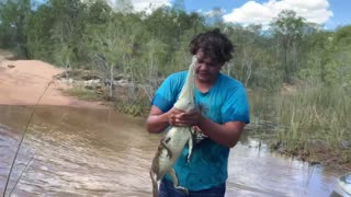 Man Catches Freshwater Crocodile with Bare Hands