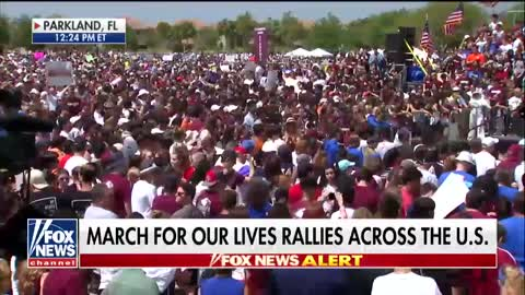 Teens protected by armed police protest guns at rallies nationwide