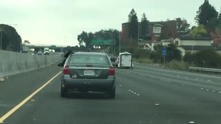 Long Dread Locks Hanging Out Of The Window On The Freeway! - Video