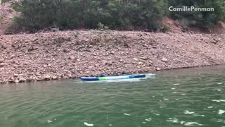 Guy lands on top of a girl on a paddle board - Video