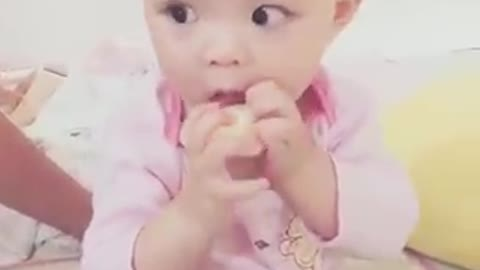 The feeling of baby eating yogurt