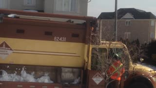 Garbage Man Shoveling Snow Into The Truck - Video