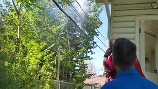 Electrical line popping and exploding eventually falls everyone watches and walks back - Video