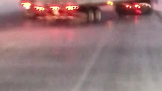 Wind Whips Trailer into Passing Truck