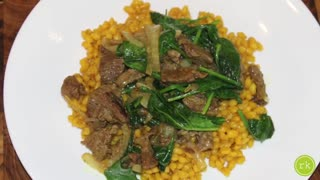 How to make turmeric barley with caramelized onions, beef & spinach