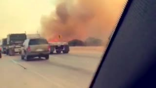 Canyon Fire Dangerously Close to Freeway - Video