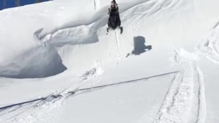 Snowmobile ledge faceplant snow - Video