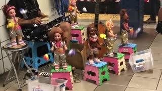 Man plays xylophone with toys around