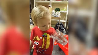 Little Boy Is Confused By Decorative Cup
