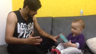 Cute Baby Interrupts Father Trying to Sing - Video
