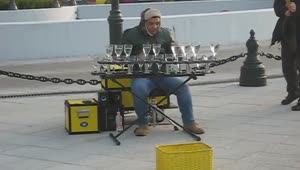 Street performer amazingly plays music on water glasses - Video