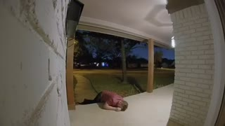 Guy red shirt falls on front porch