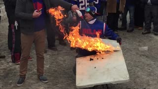 Crazy Buffalo Bills Fan Catches Himself on Fire - Video