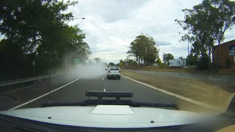 Car Disappears in Cloud of Smoke