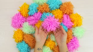 How to create a colorful pom-pom rug - Video