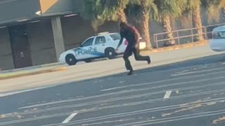 Police Car Crashes into Parked Car