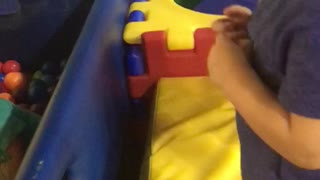 Little kid dives face first into ball pit - Video