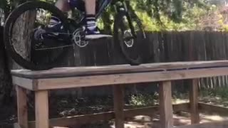 Bike face plant from wooden plank