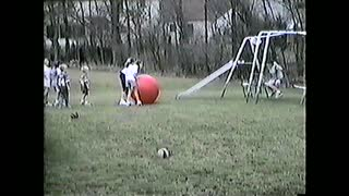 Swinging Girl Kicks Giant Red Ball That Hits Boy In The Face - Video