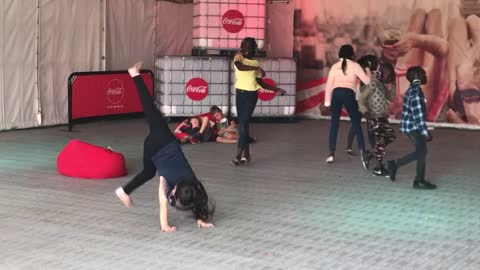 Little Girl Fails at Handstand at the Silent Disco
