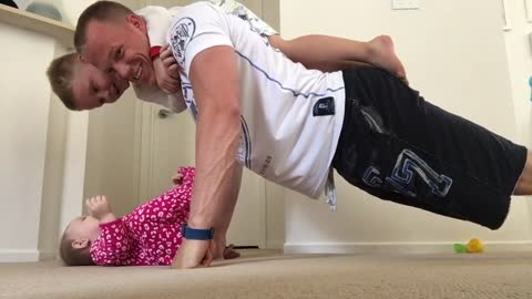 Daddy Exercising with the Kids