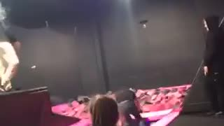 Guy jeans black shirt tries to trampoline jump into pink foam pit fail - Video