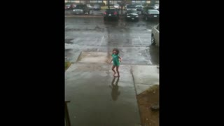 Little Girl Dancing In The Rain Gets Scared By Thunder - Video