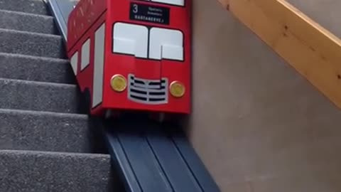 This Pup Goes Down The Stairs With The Help Of A Pimped-Out Stairlift