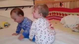 Twins engage in adorable battle for tablet