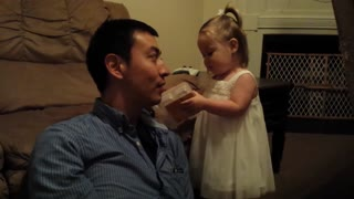 Toddler laughing at her hilarious Father