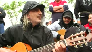 Music lifts spirits in migrant camp