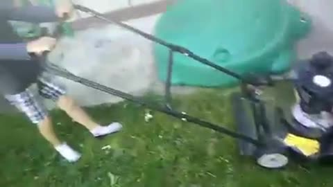 Six year old mowing the grass
