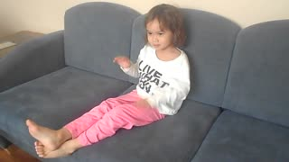 Girl has a funny way of sitting and watching tv - Video