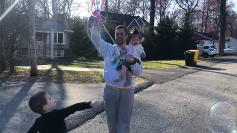 Baby girl gets super excited over daddy creating huge bubbles
