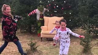 Screaming kids run in fear from 'Grinch' photoshoot prank