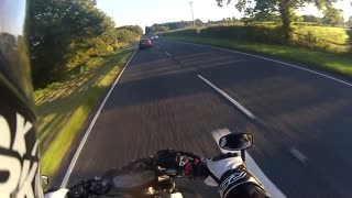 Biker's camera captures high speed near miss