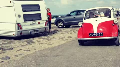 Old Car Rolling At The Beach