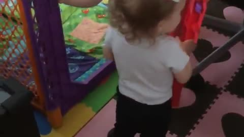 Twins lock each other out of play-yard in cutest way