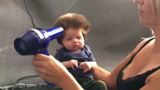 Nine-Week-Old Baby Has A Full Head Of Bouffant Hair - Video