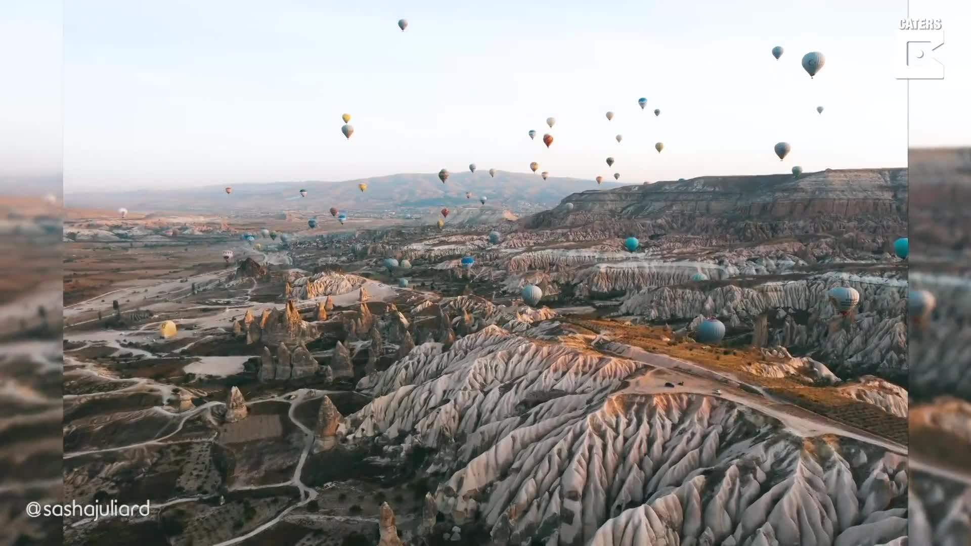 SPECTACULAR VIEWS SHOW HUNDREDS OF HOT AIR BALLOONS RISE WITH THE SUN