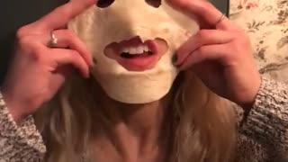 Girl bites eye and mouth holes into tortilla and sticks out tongue