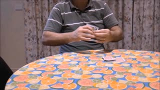 A Playing Card Slices Into The Magician's Arm  - Video