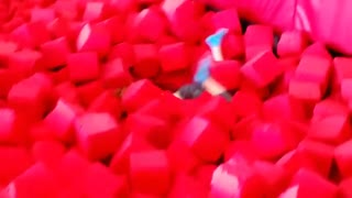 Blue sock girl yellow shirt foam pit - Video