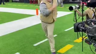 You won't believe this NFL photographer's dance moves!