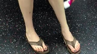 Woman shaves legs with pink razor on subway - Video
