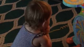 Baby rocks out to daddies drumming  - Video